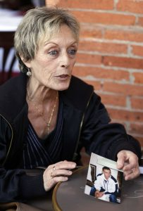 Dominique Bons shows a photo of her son Nicolas, a young convert to Islam who has died fighting in Syria, during an interview with Reuters in Toulouse