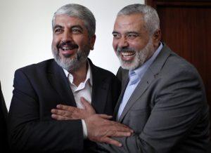 Hamas chief Khaled Meshaal hugs senior Hamas leader Ismail Haniyeh before leaving Gaza Strip
