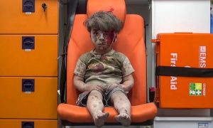 Five-year-old Omran Daqneesh sits in the back of an ambulance after a military strike in the rebel-held neighborhood of Qaterji in Aleppo. Mustafa al-Sarout/ALEPPO MEDIA CENTER
